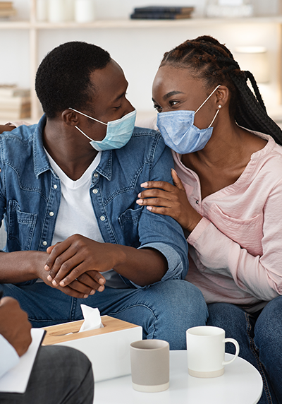 Couple Wearing Masks While In Therapy