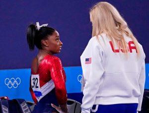 Simone biles talking to a Coach